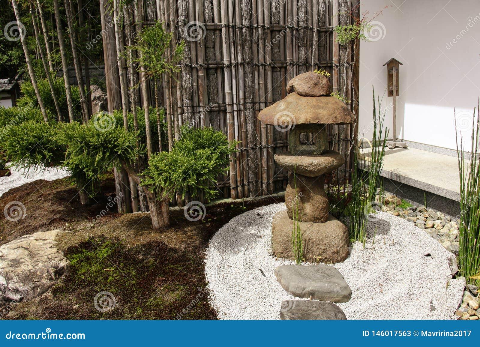 Stone Lantern And Bamboo Partition In Traditional Japanese Zen Garden In Hasedera Kamakura Japan Stock Image Image Of Japan Buddhist 146017563