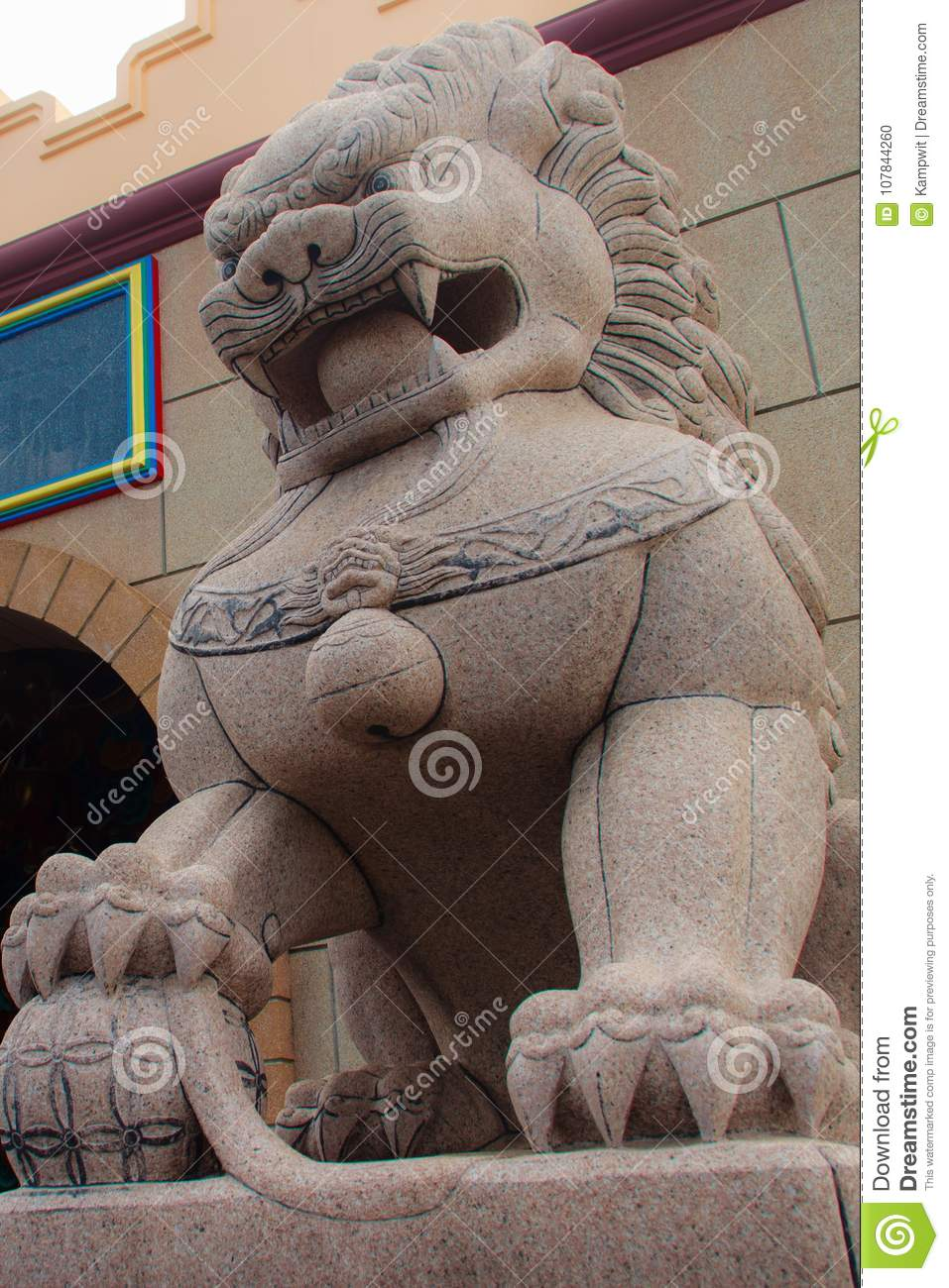 Stone Lion Guardian statue at the entrance gate of Anek Kusala S