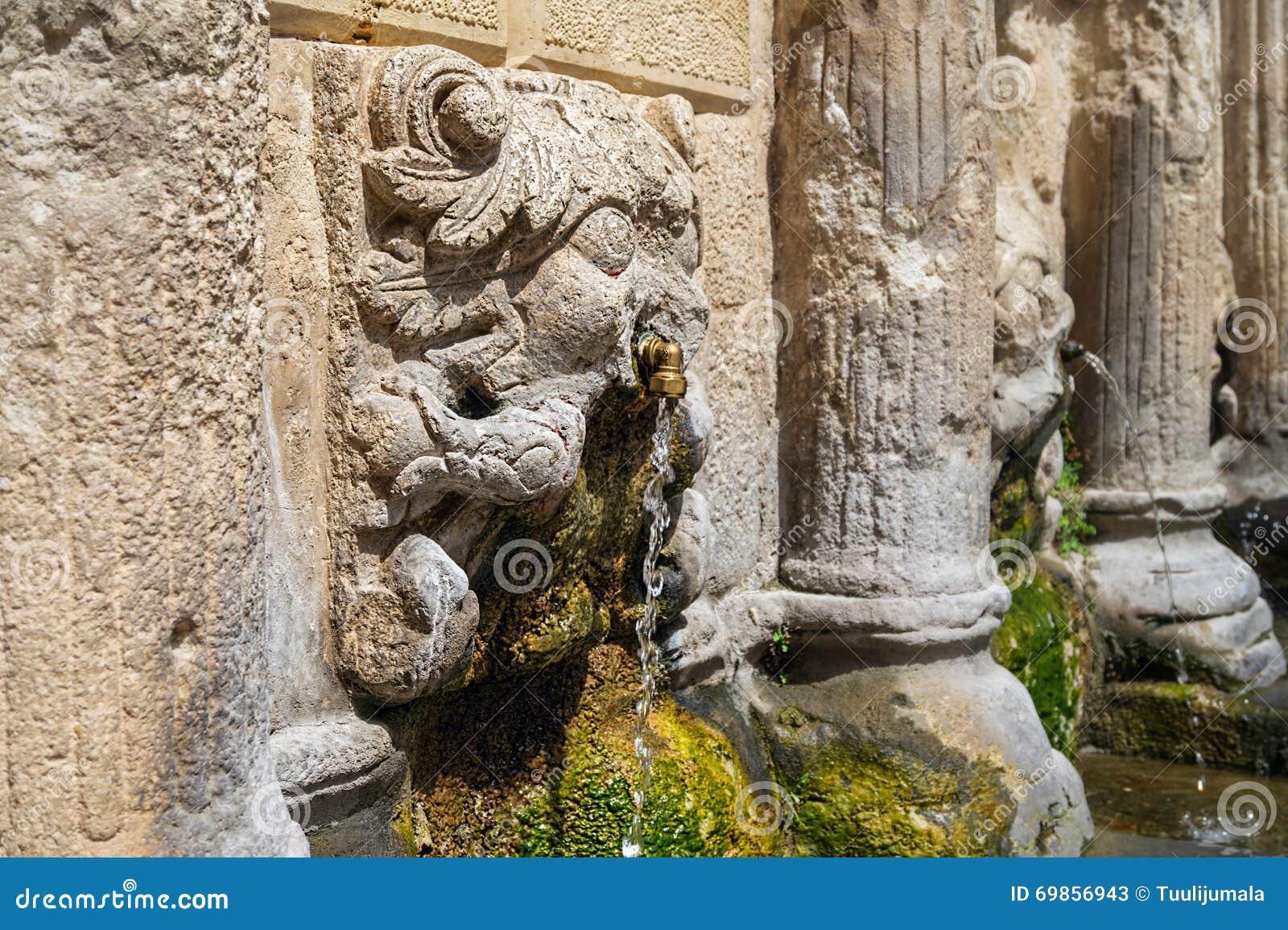 Stone lions head of Rimondi Fountain