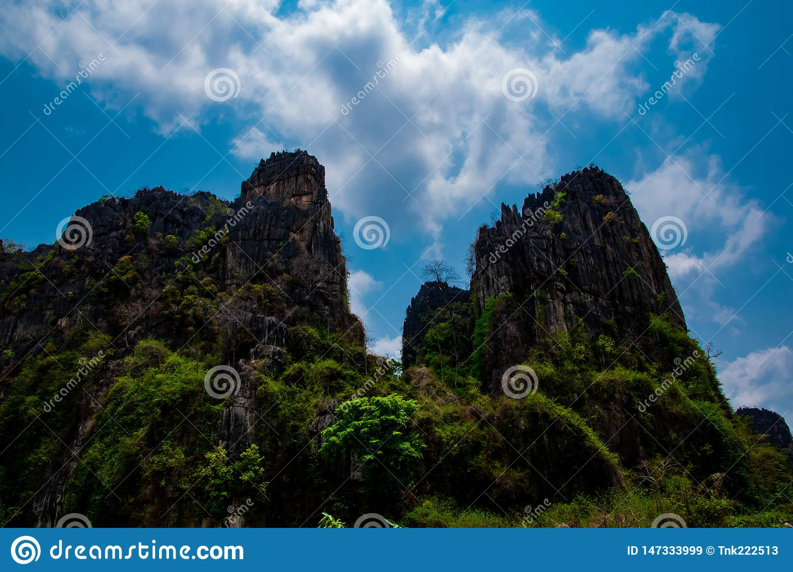 Stone mountains view and beautiful blue sky background at Banmung, Neonmaprang, Pitsanulok , northern of Thailand.