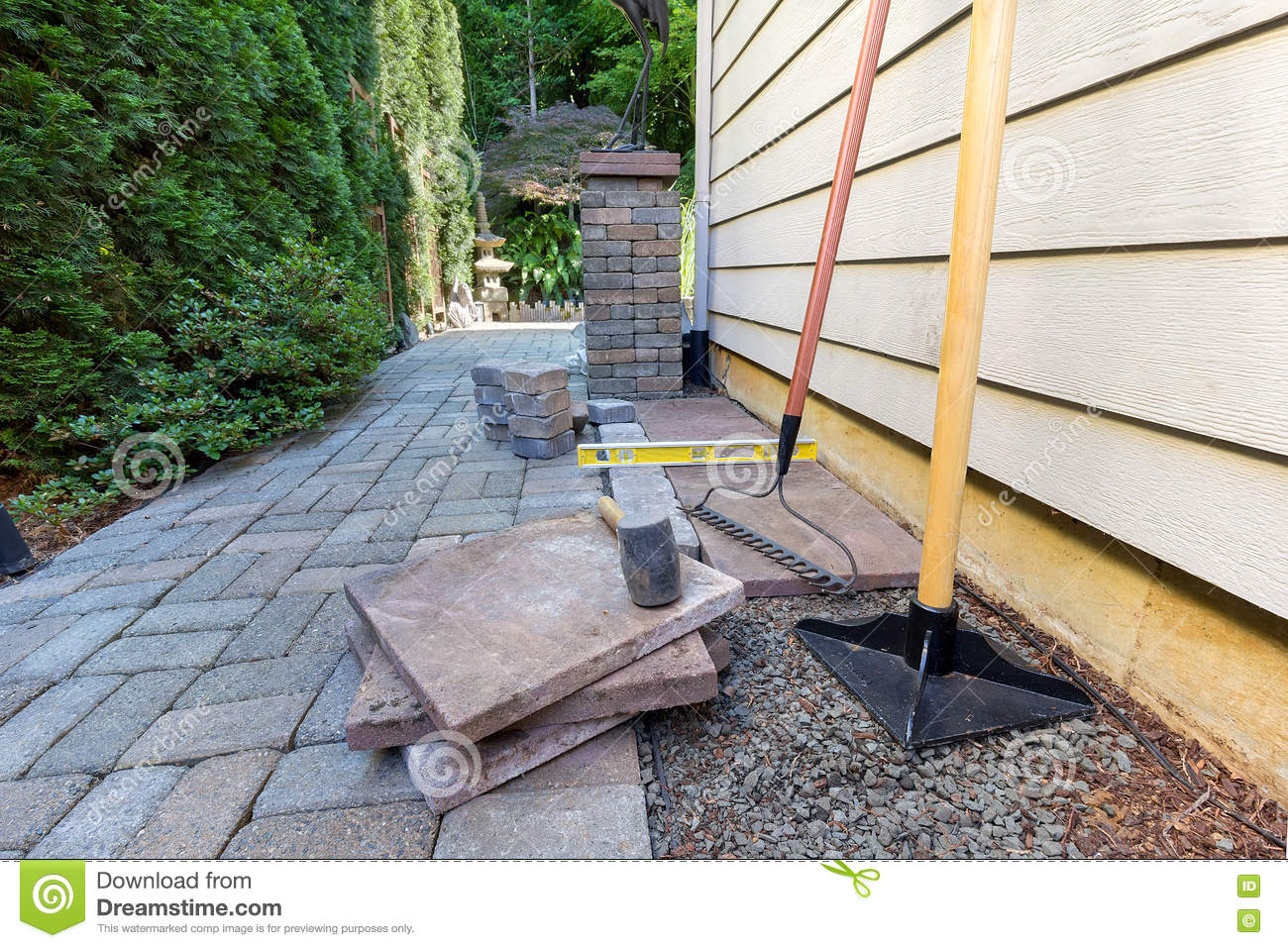 Stone Pavers And Tools For Side Yard House Landscaping