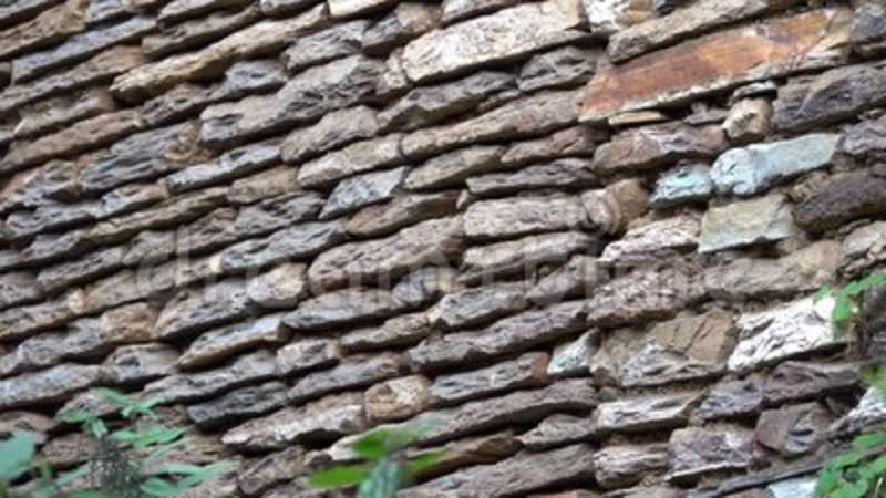 Stone Retaining Wall of Traditional Rural House in Nepal. Shot with a Sony a6300 59,94 fps FHD stock video footage