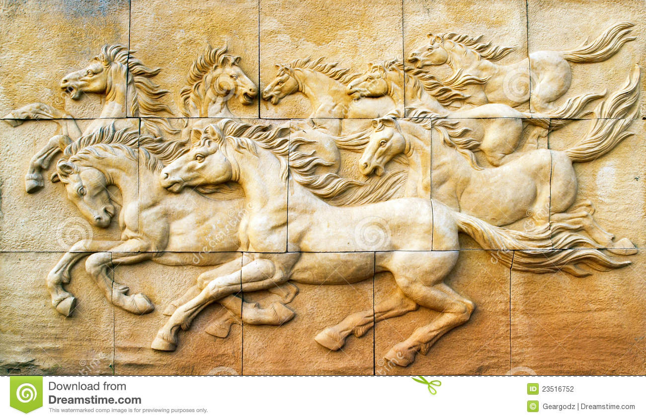 Stone sculpture of horse on wall stock photography image