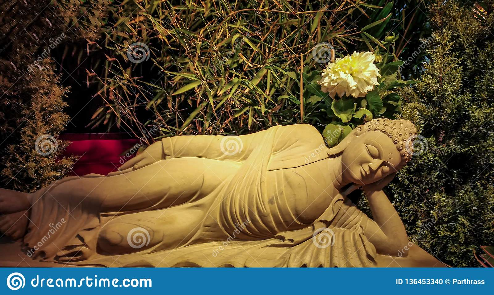 stone sculpture of sleeping lord buddha closed up