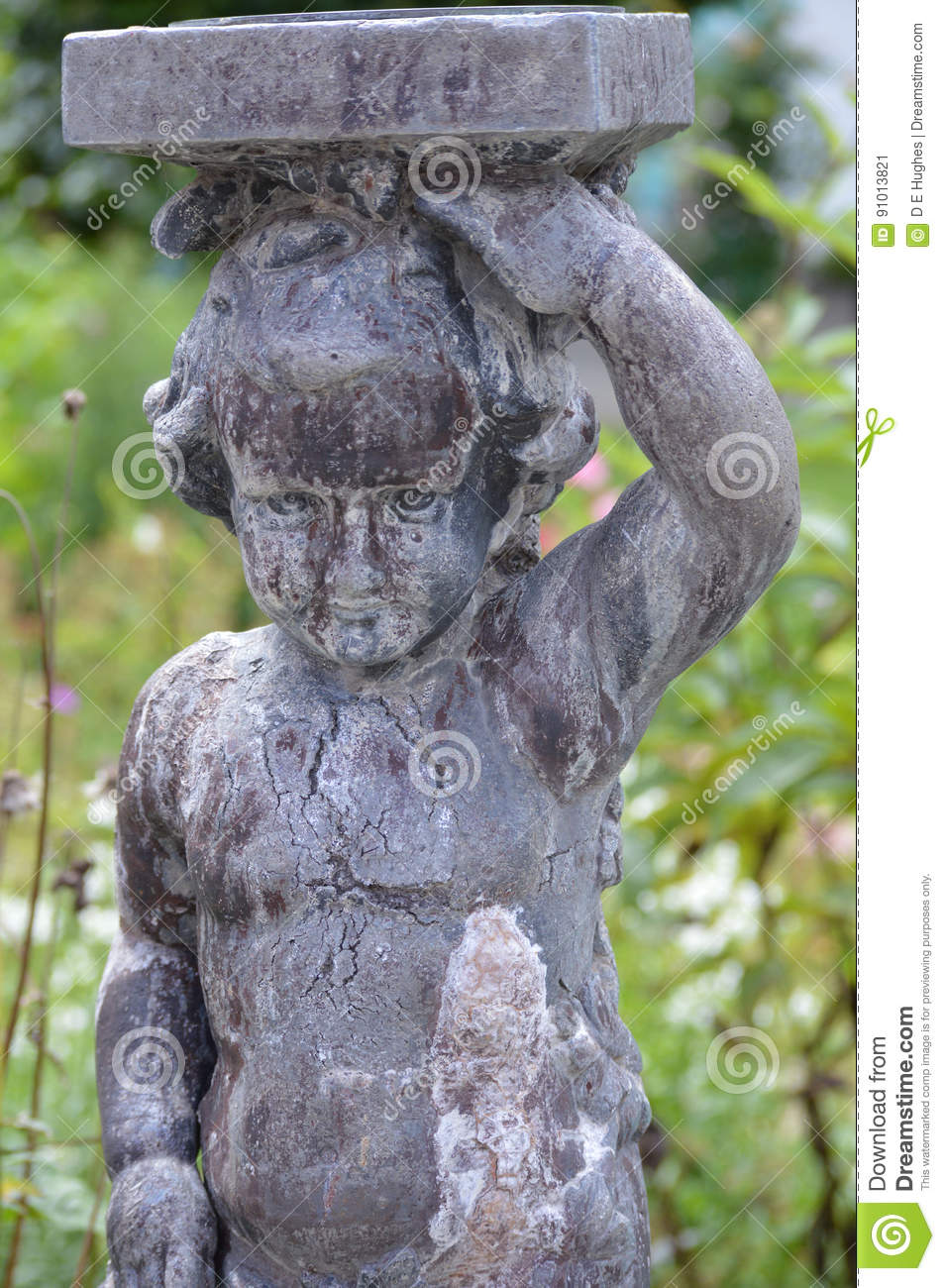 Stone statue of a child - Portmerion Village in Wales