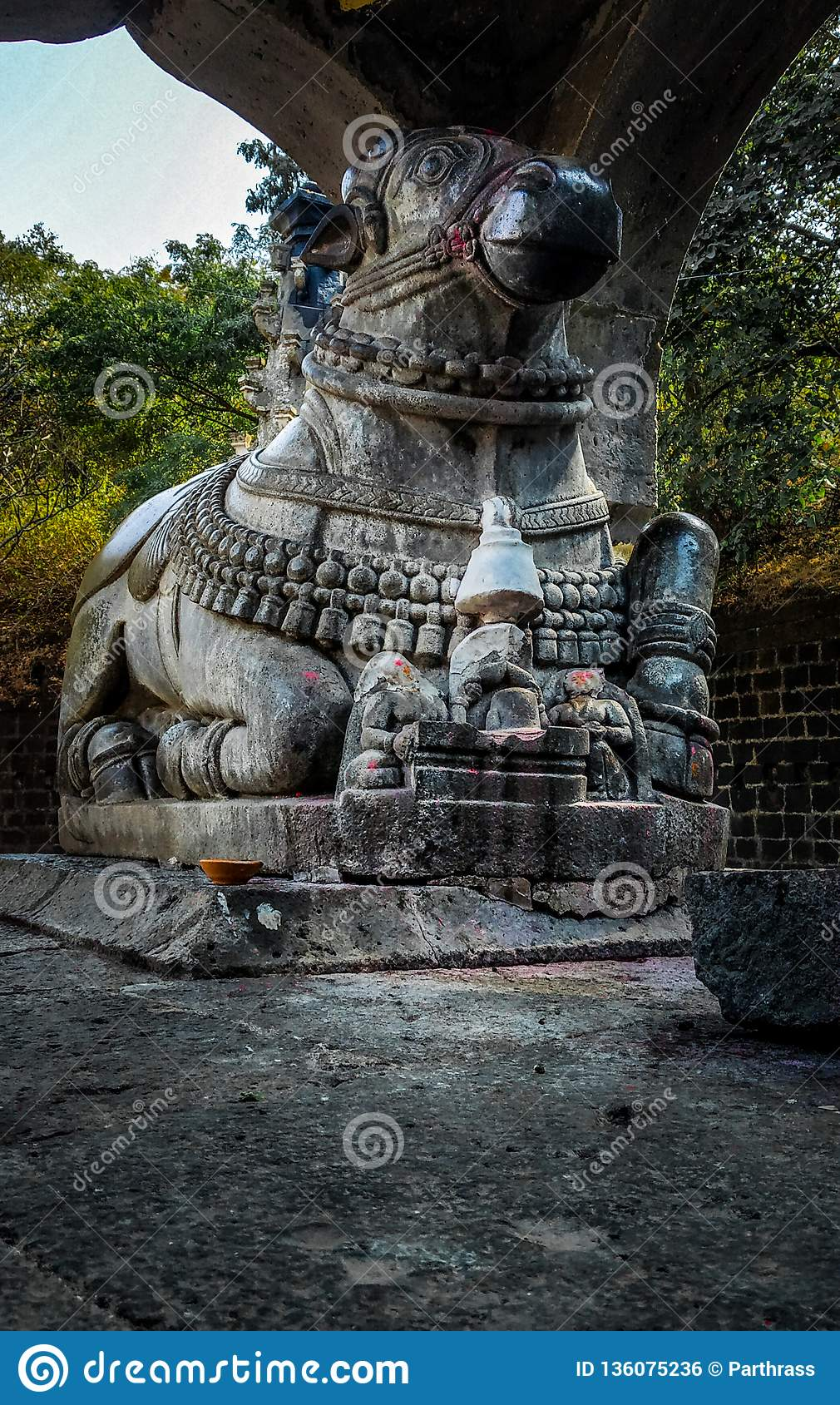 stone statue of nandi in an old ancient temple