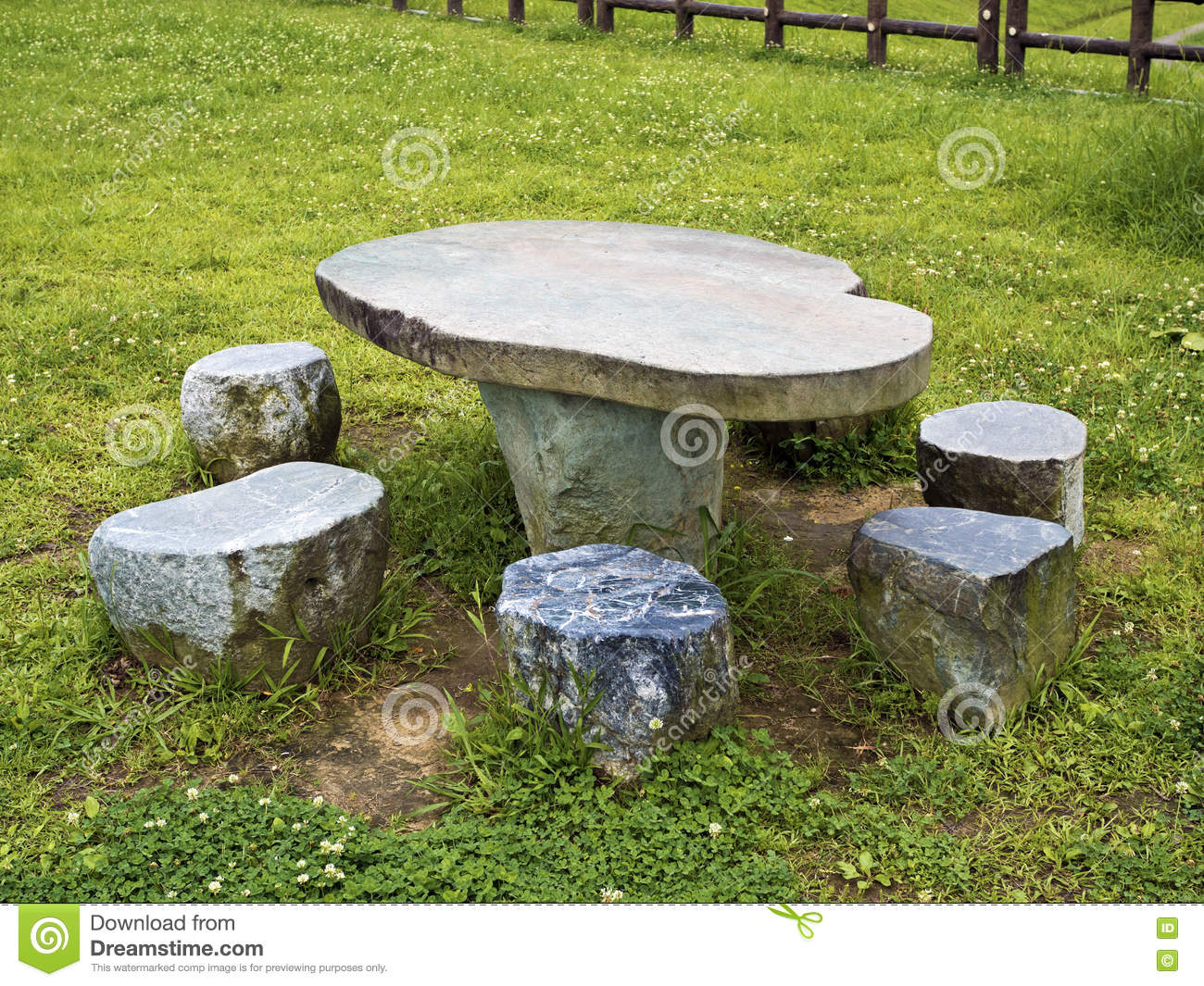 Stone Table And Seating Benches In Park