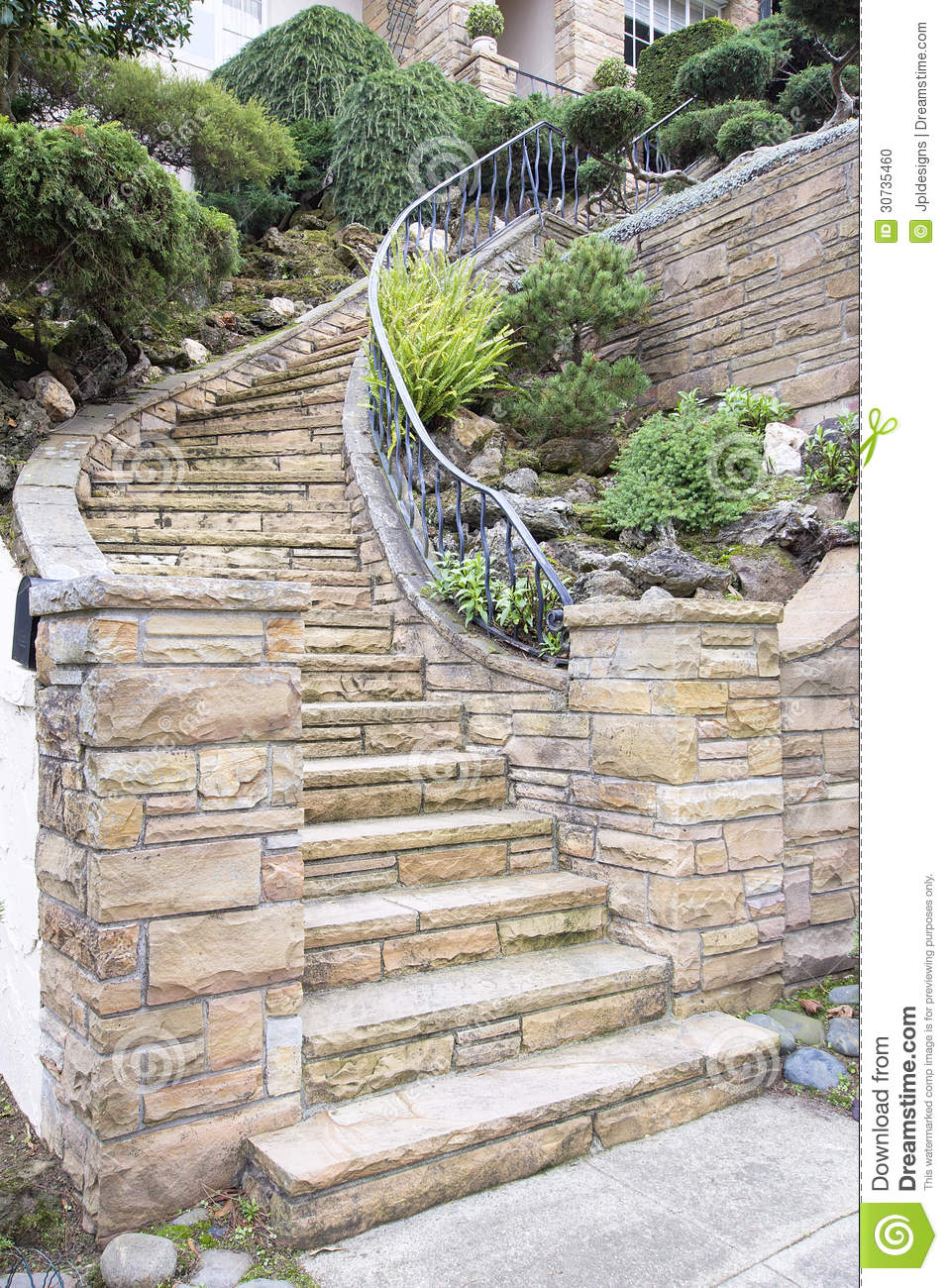 Stone veneer facade on home exterior staircase stock photo - Escaleras para jardin ...