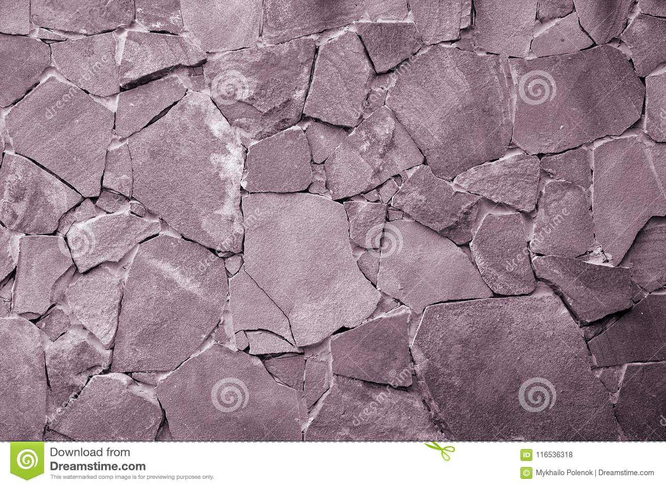 Stone wall background - building feature. Texture of thick and strong wall of rough stones of various shapes and sizes