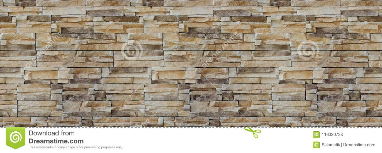 Stone wall brick texture. Seamless pattern. Background of the Sandstone facade.