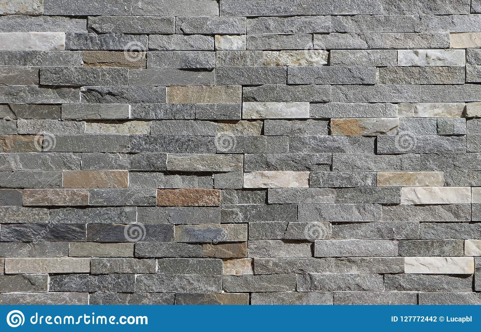 Stone Wall Cladding Made Of Horizontal Gray Brown And White Strips Of Rock Stacked Stock Photo Image Of Background House 127772442