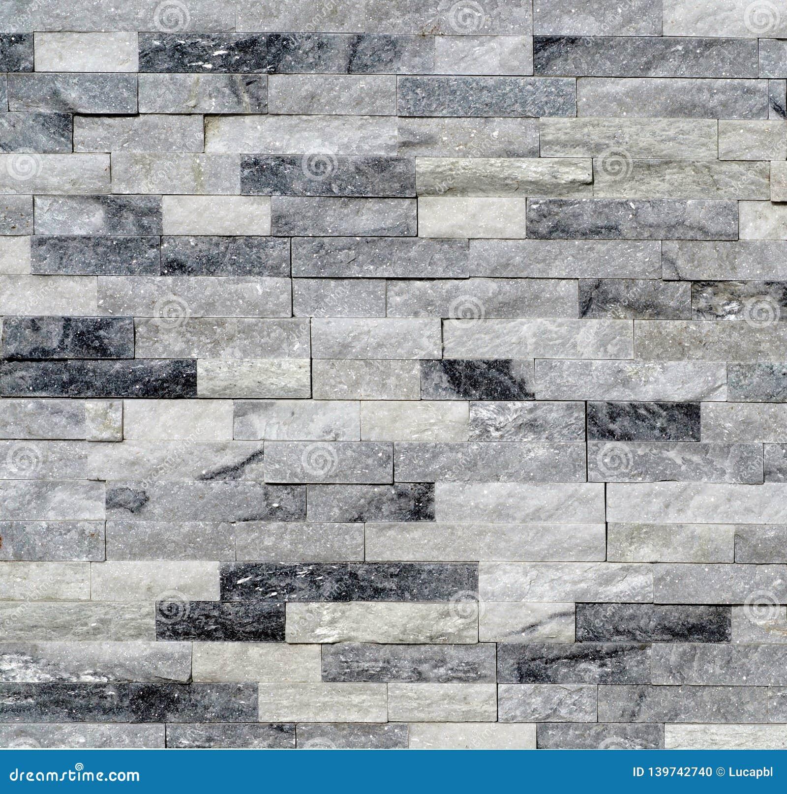 Stone wall cladding made of white and gray quartzite bricks