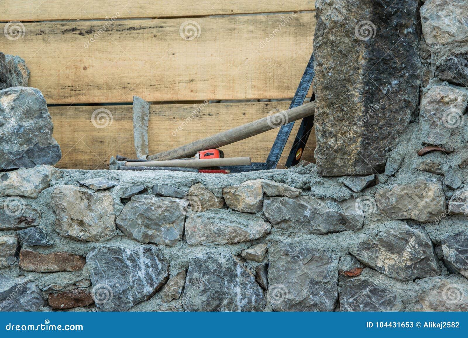 Stone wall construction and masonry tools