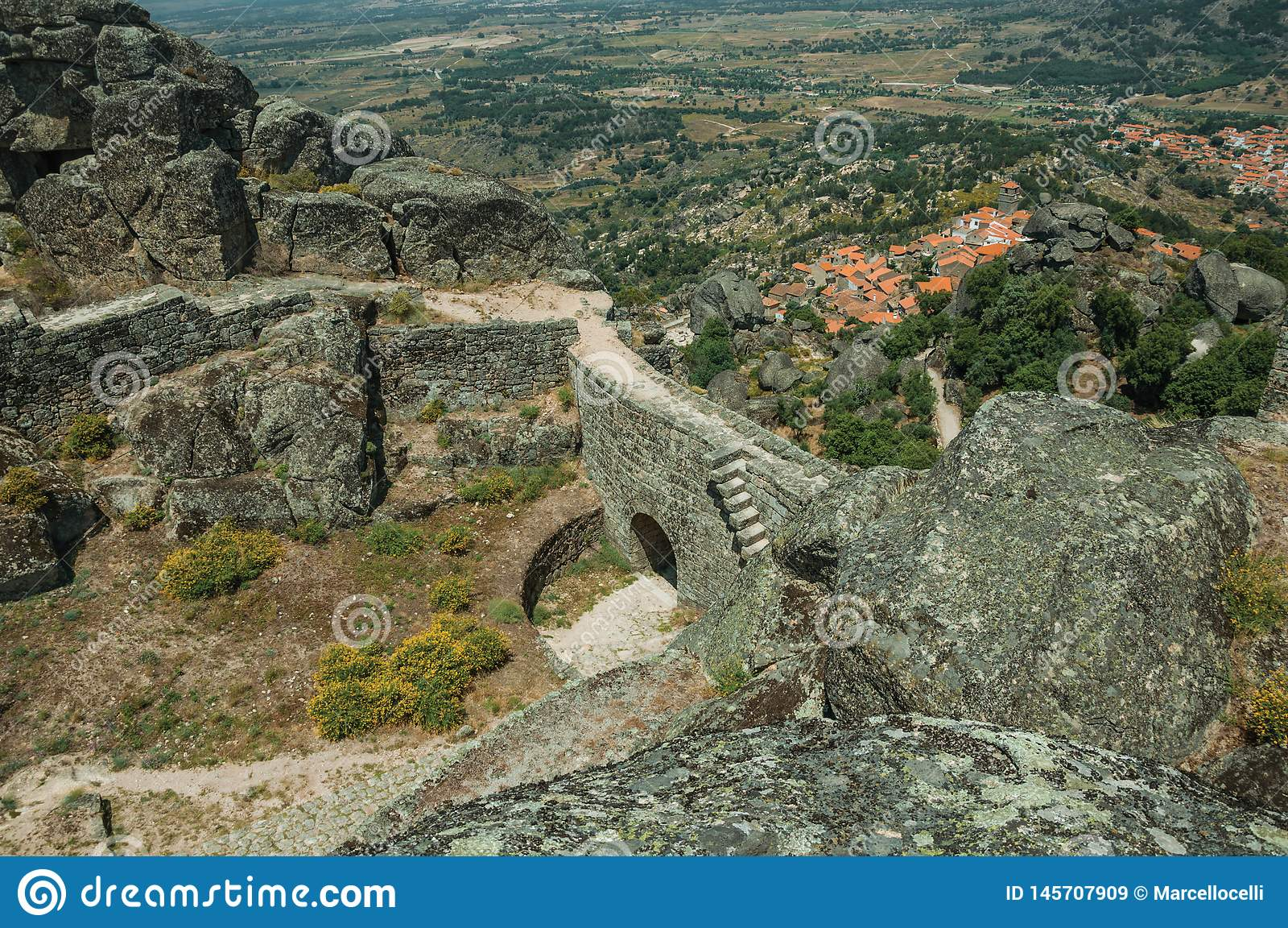 Stone wall with gateway and landscape at the Castle of Monsanto