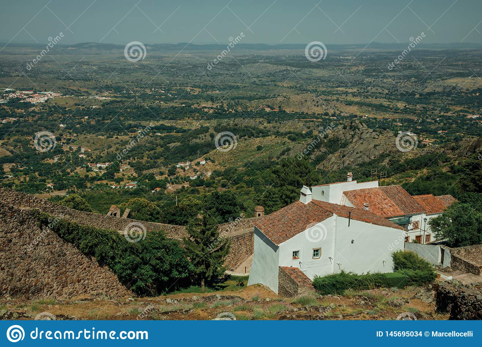 Stone wall and old white houses in Marvao
