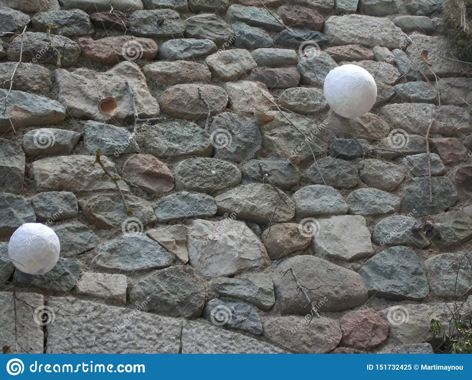 Stone wall with ornaments hanging in a medieval towe