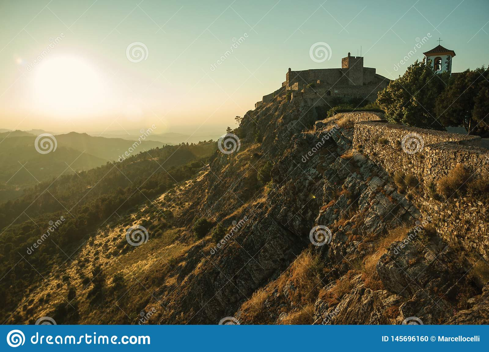 Stone wall and tower of Castle over ridge in Marvao