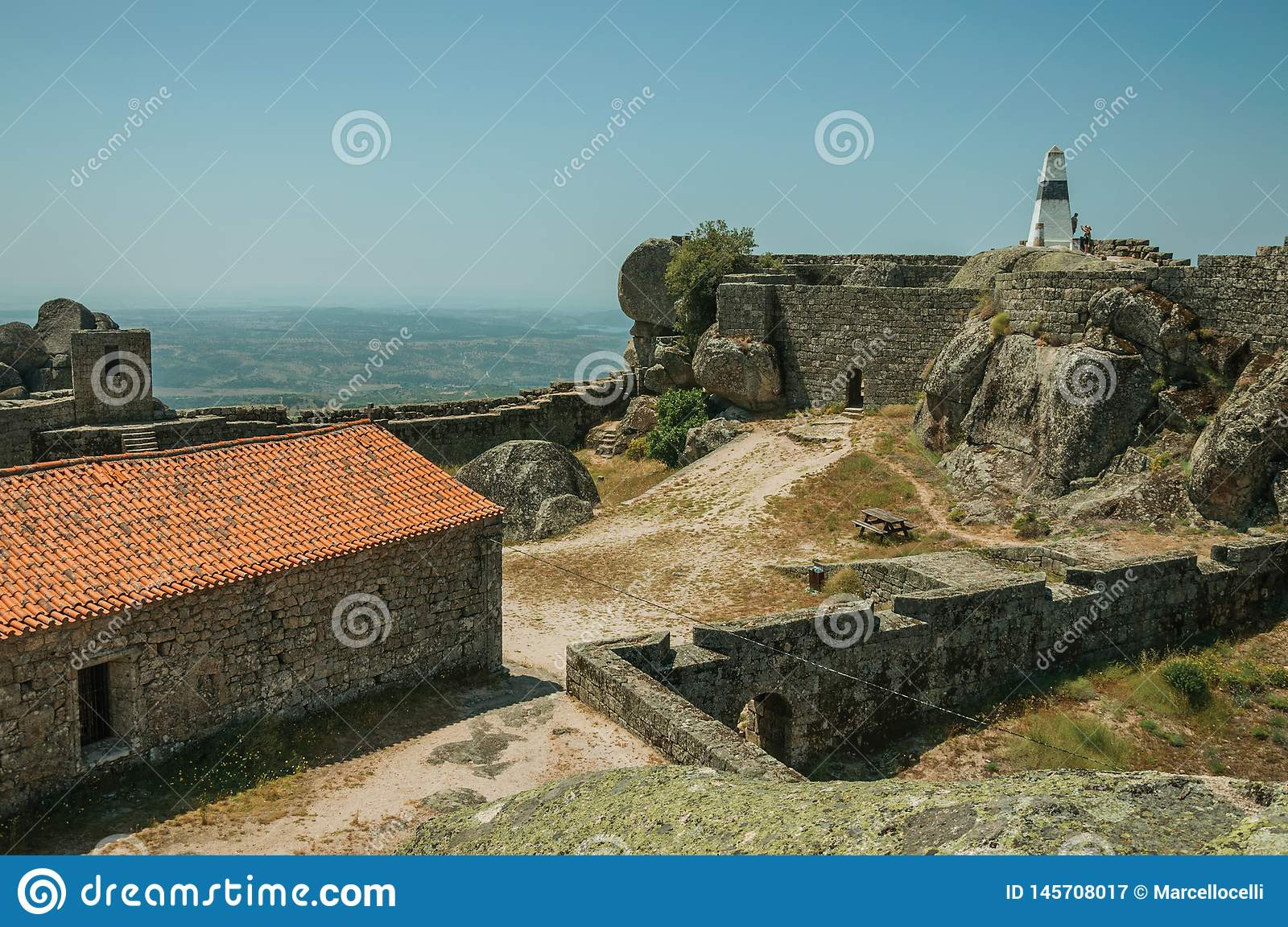 Stone walls encircling an old chapel at the Castle of Monsanto