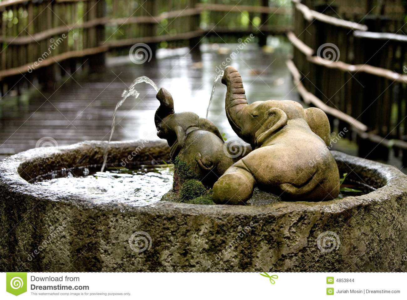Stone Water Feature In The Shape Of Two Elephants Stock