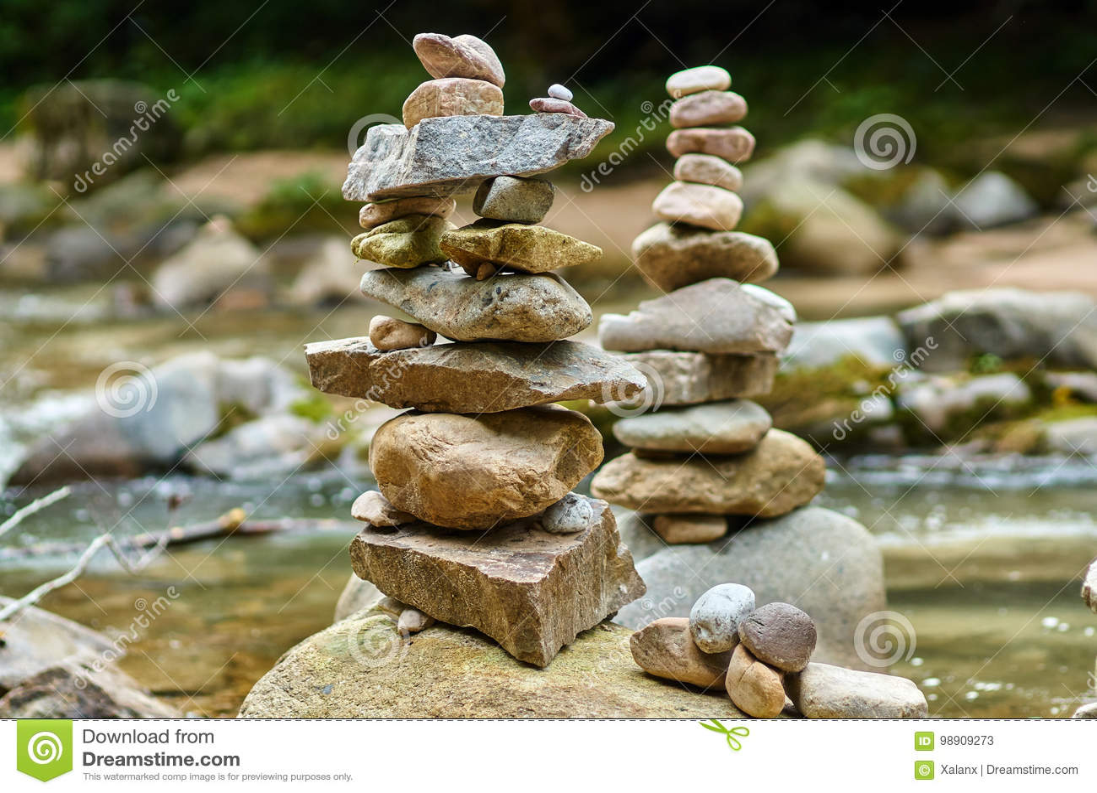 Stones arranged zen-like by the river