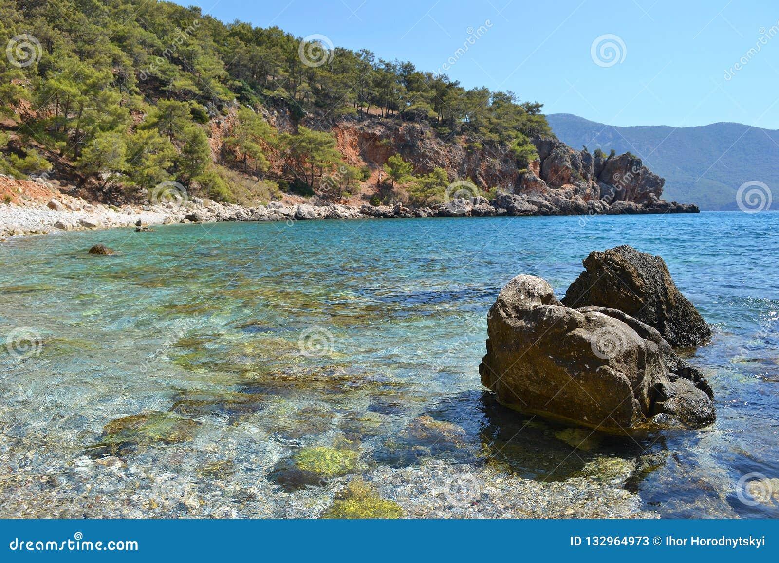 Stones in a beautiful azure sea bay