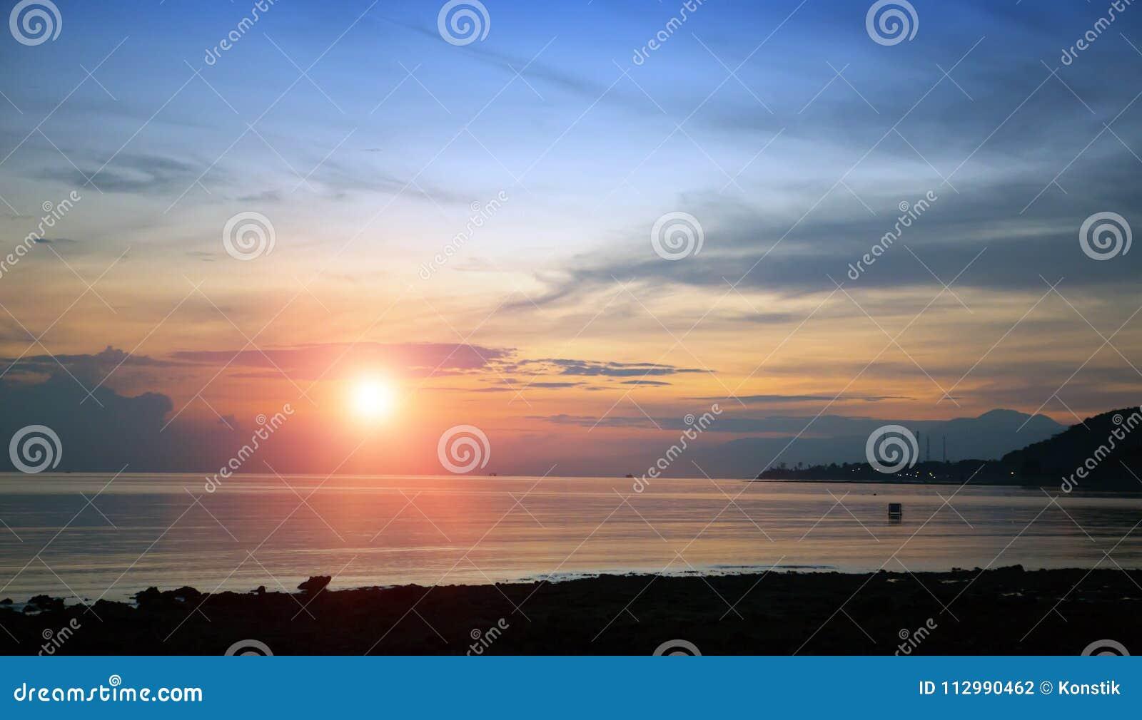 Stony seacoast on a sunset. Indonesia. Bali