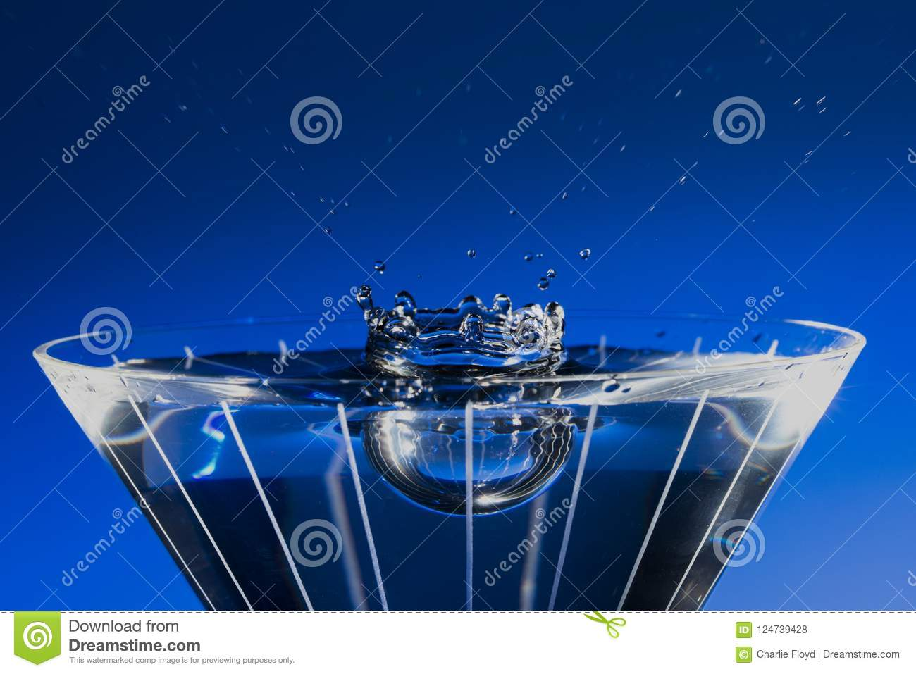 Download Stop Motion Martini Glass Blue Splash Stock Photo