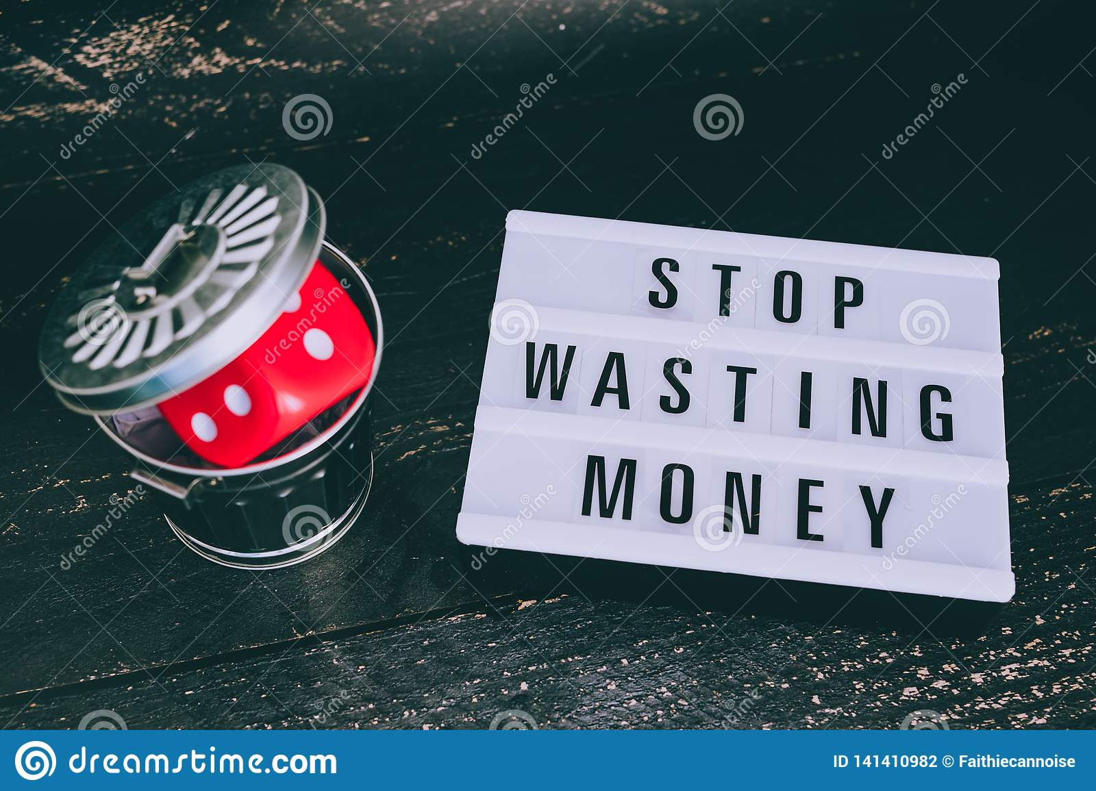 Stop wasting your money message on lightbox with gambilng dice thrown in the bin
