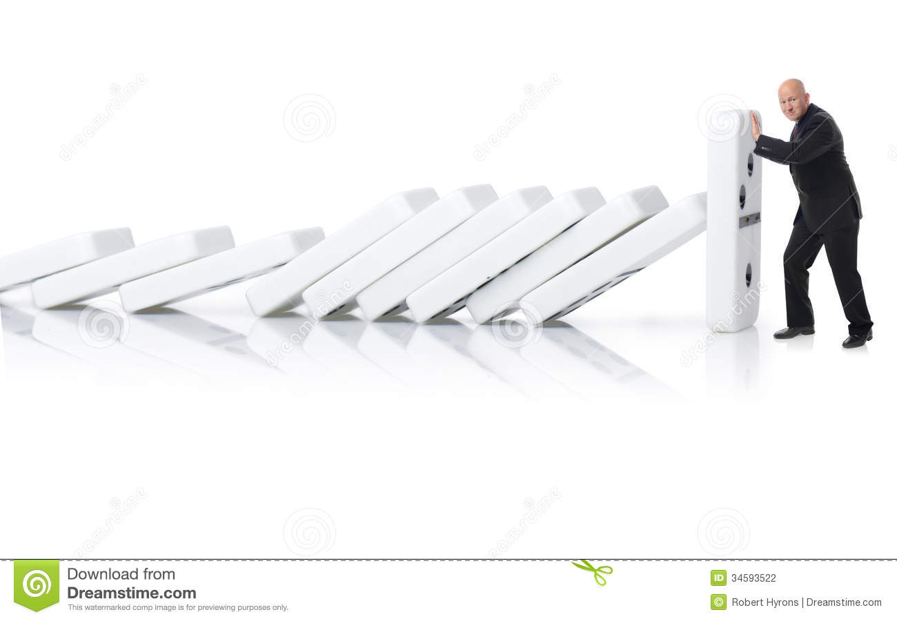 stopping a domino effect stock photography image  stopping a domino effect