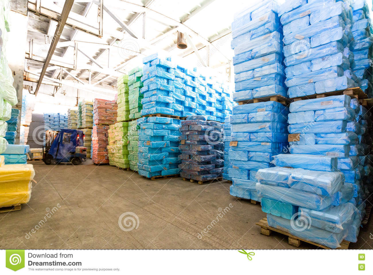 Storage at factory with wrapped in plastic boxes