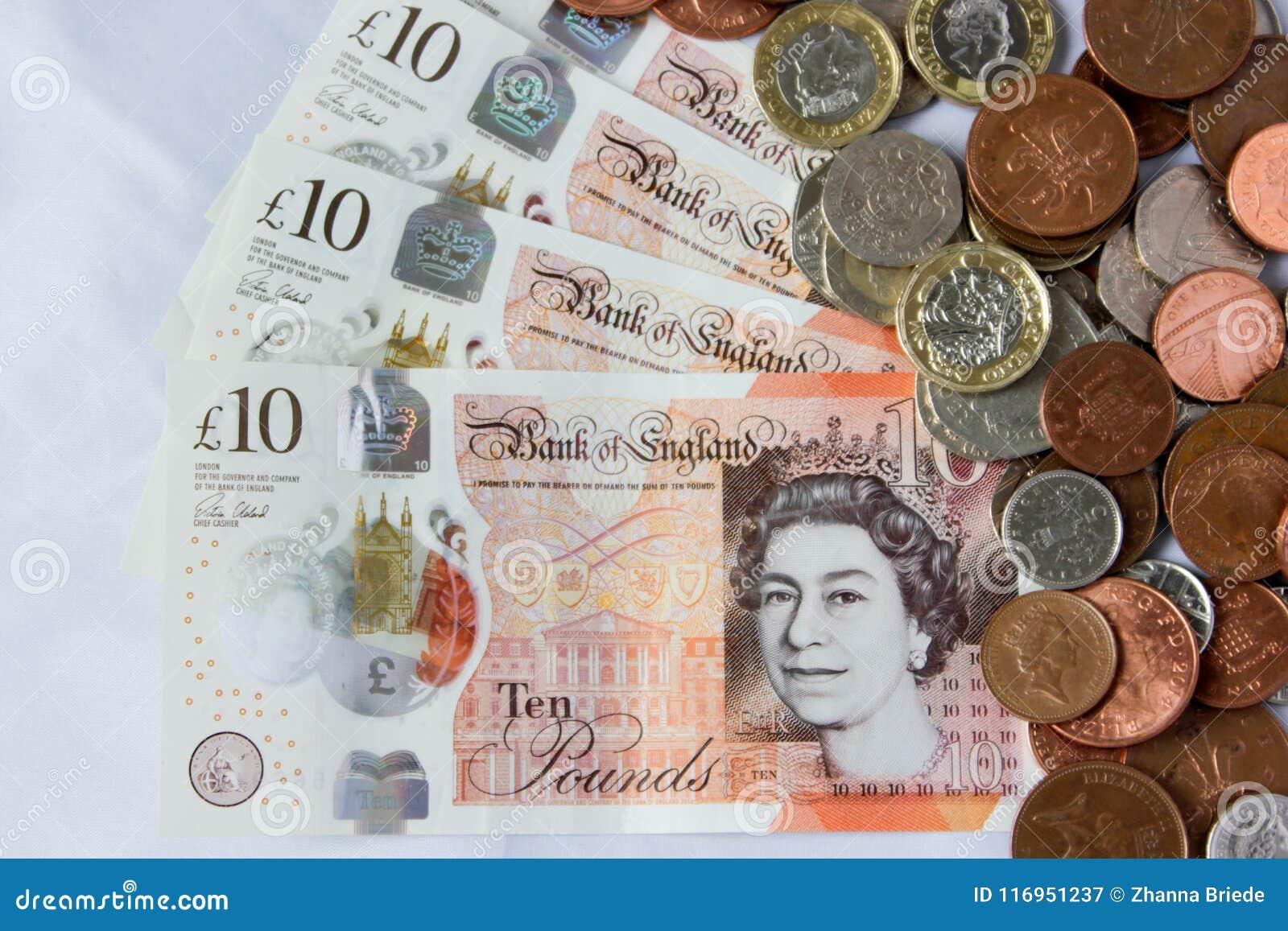 Storbritannien pund och encentmynt på vit bakgrund