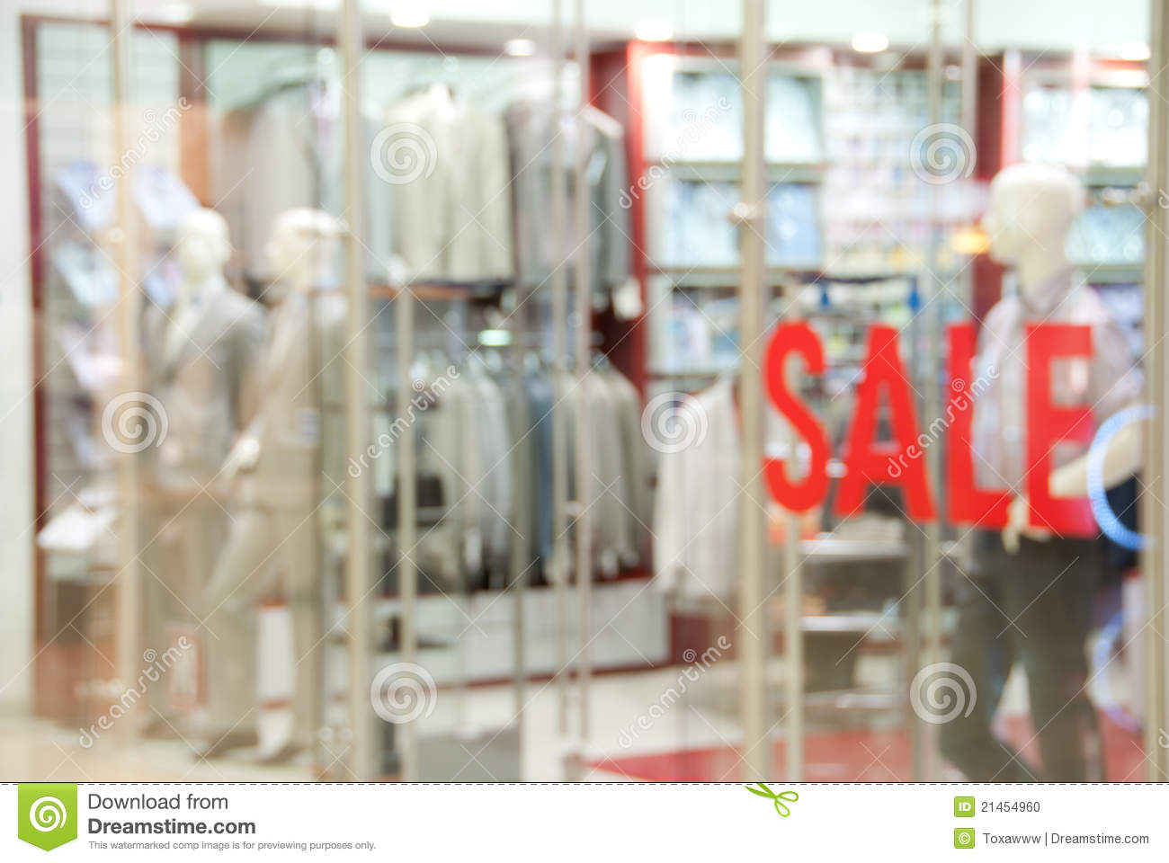 Storefront of men s clothing shop during the sale. Image not in focus