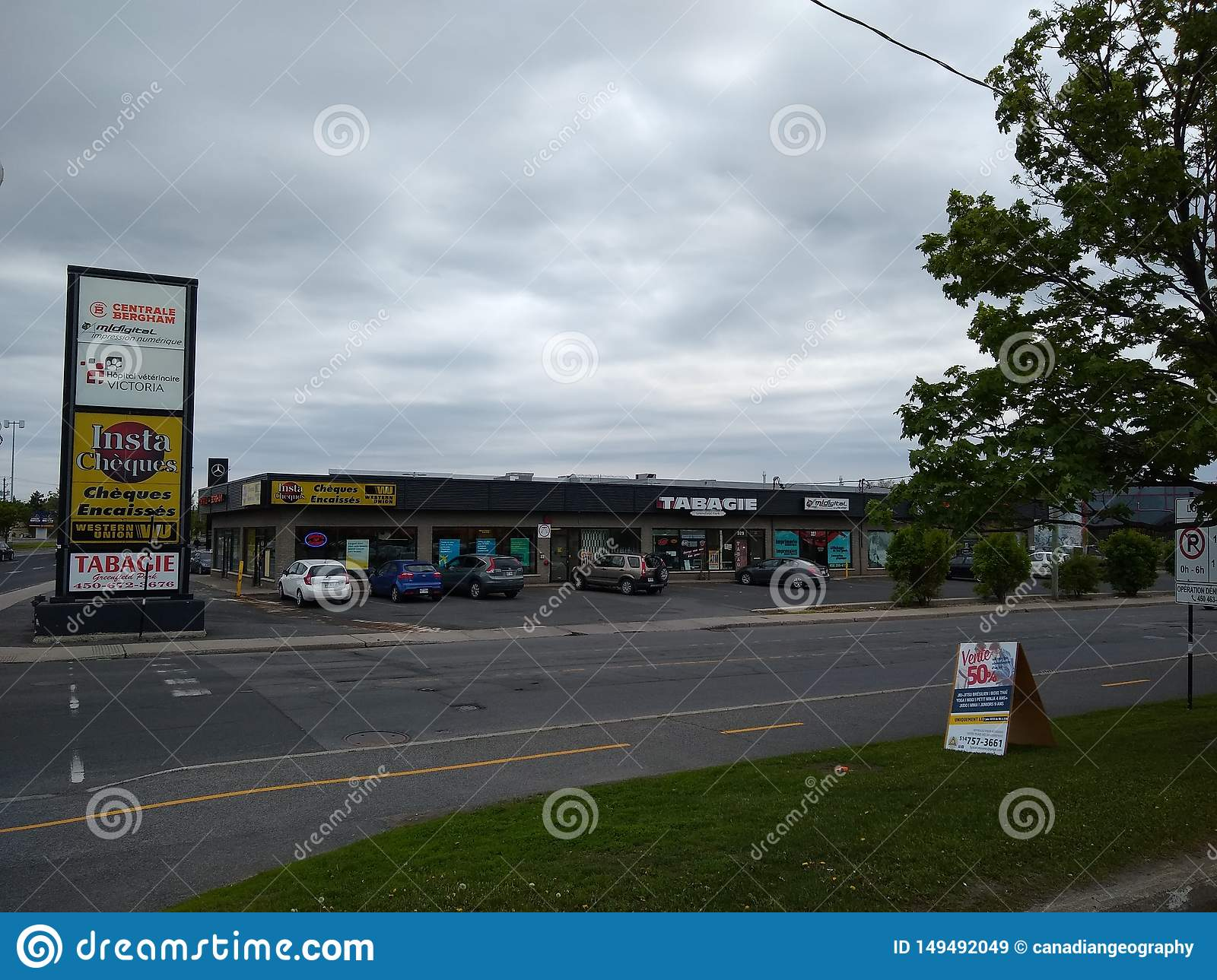 Stores viewed from across the street in Greenfield Park, Longueuil, Quebec, Canada