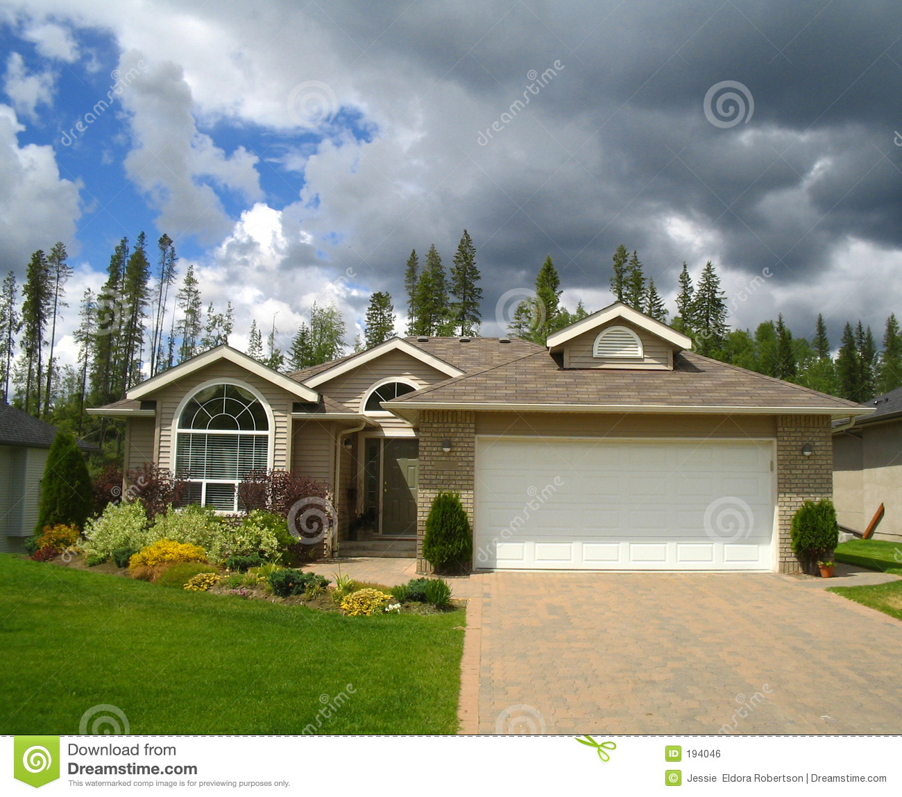 Storm clouds over nice house in the suburbs stock photo for Nice house photo