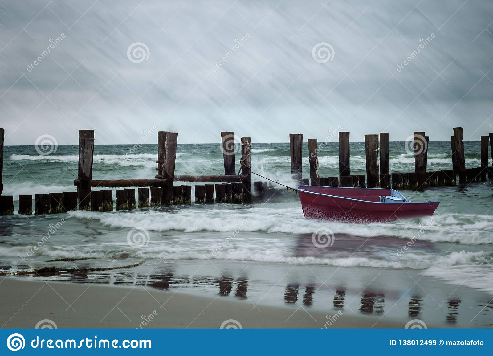 Storm on the sea with a little red boat