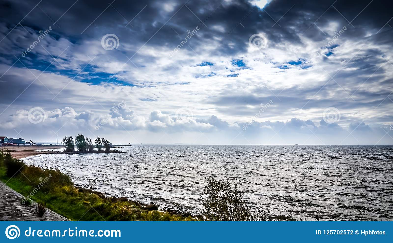 Stormy weather and dark clouds over het IJsselmeer in the Netherlands