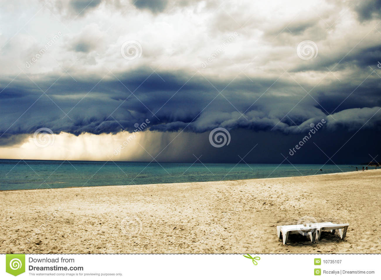 Stormy weather with rain on the beach
