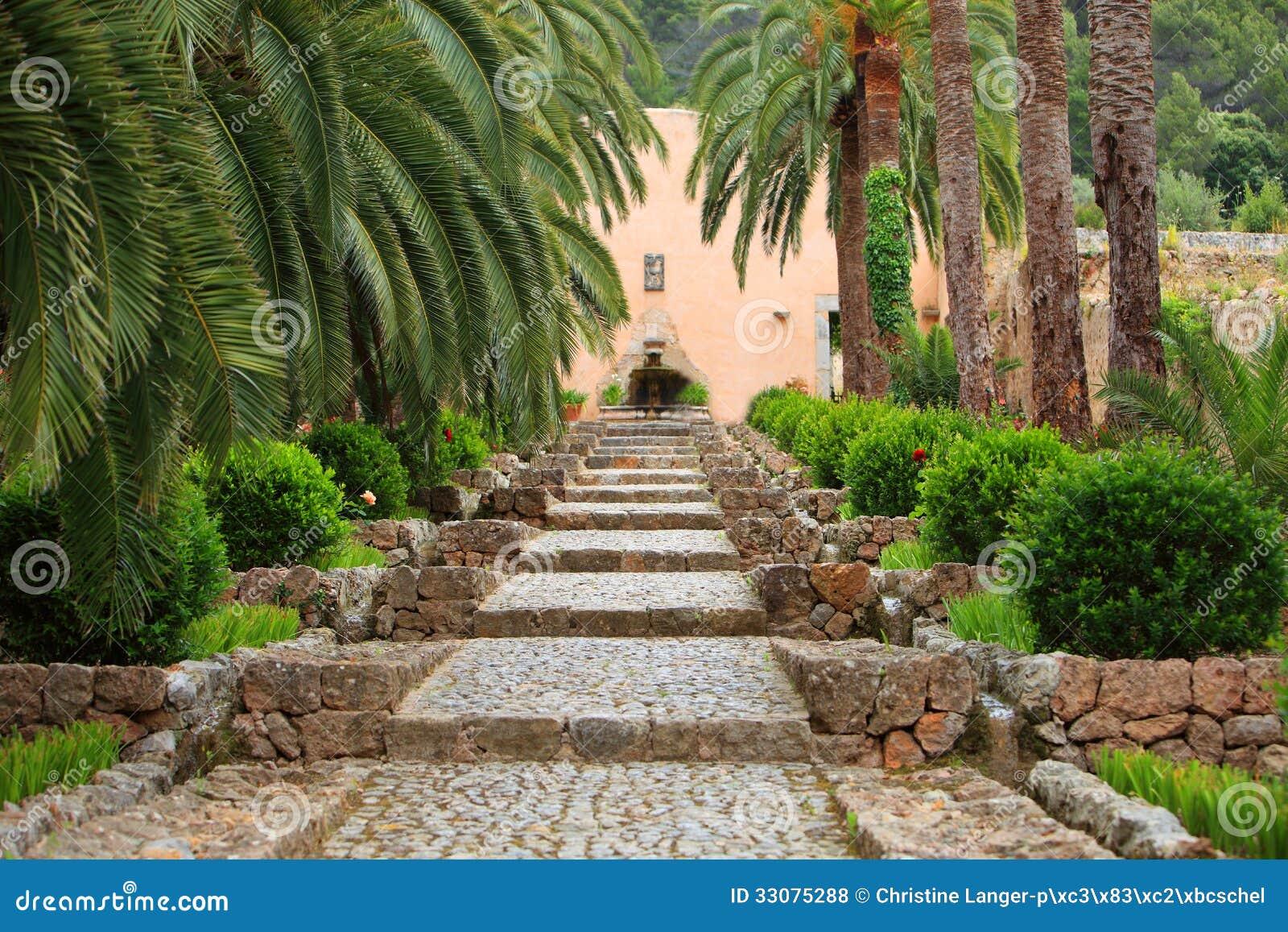 Straight Garden Walkway With Cobblestones Royalty Free