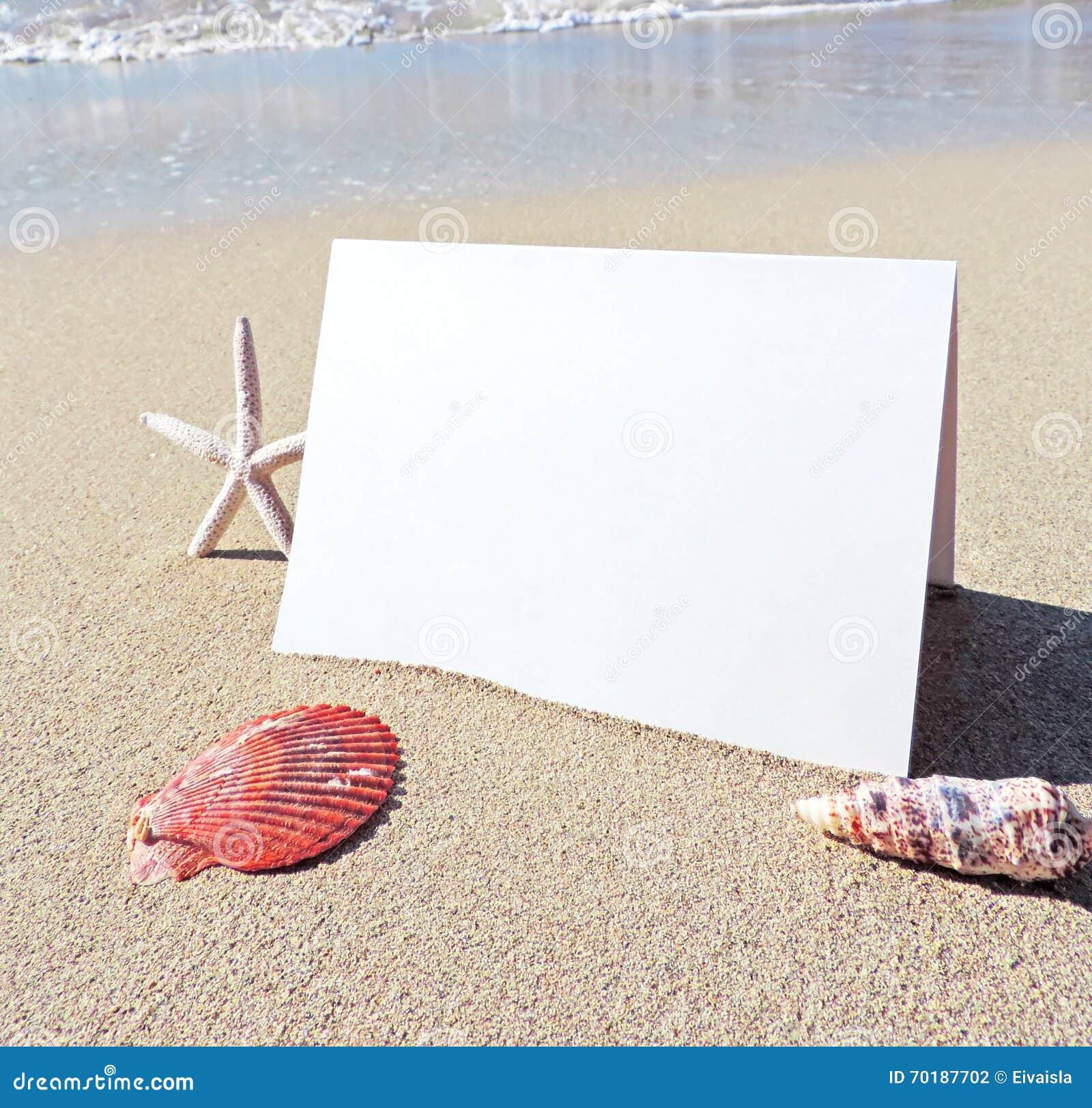 Strandplats med hälsningkortet