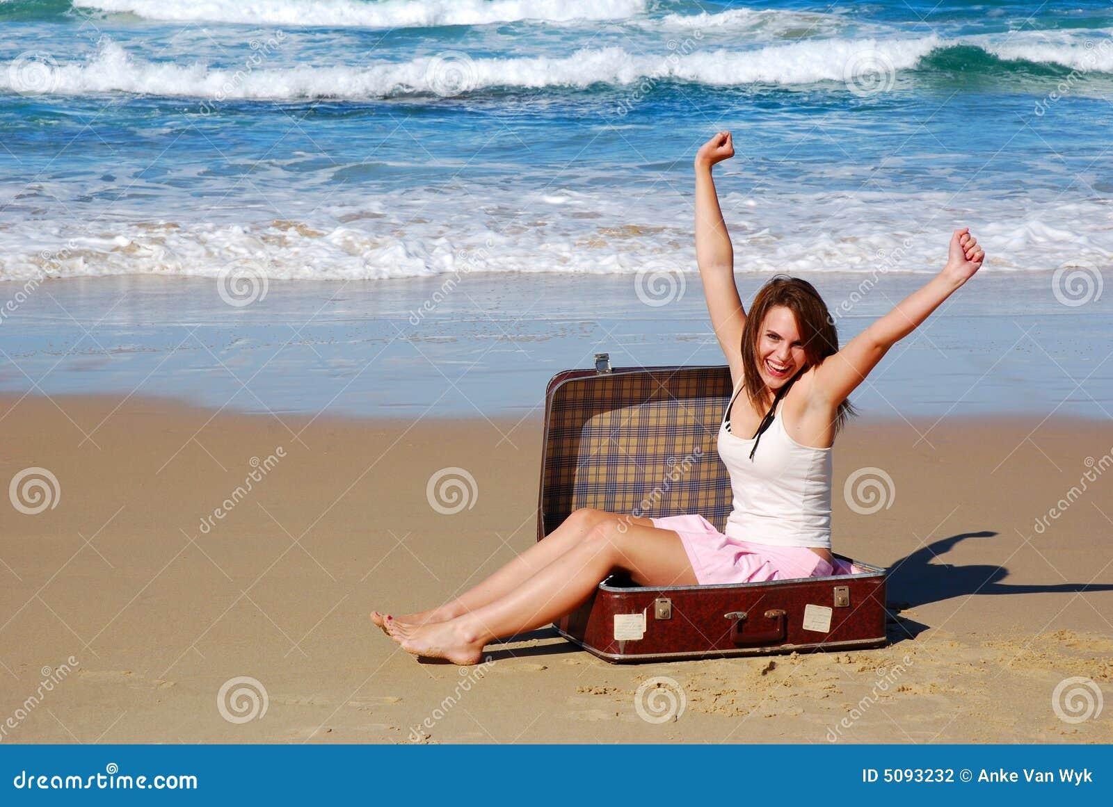 Strandsatt kvinna