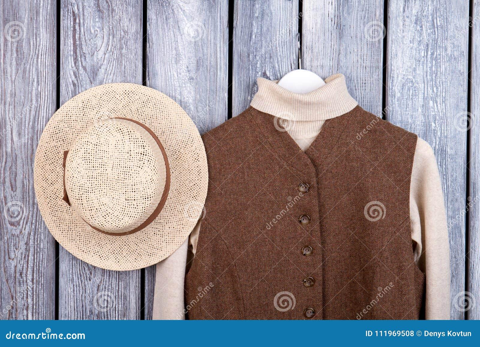 Straw Brim Hat And Wool Sweater In Sleeveless Jacket. Stock Photo ... cb474b2958e9