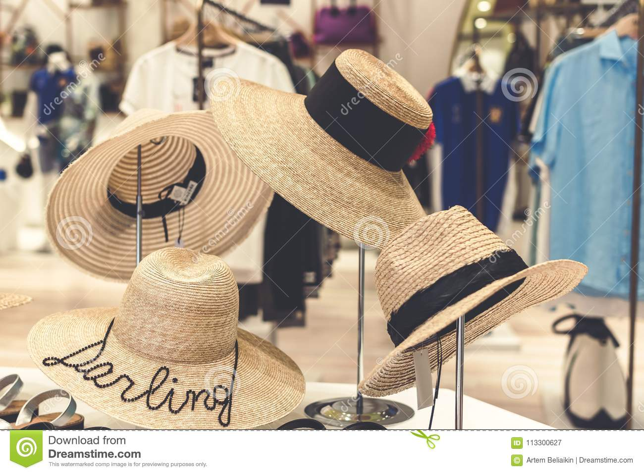 Straw hats ganging in the store. Bali. Shopping and travel concept.