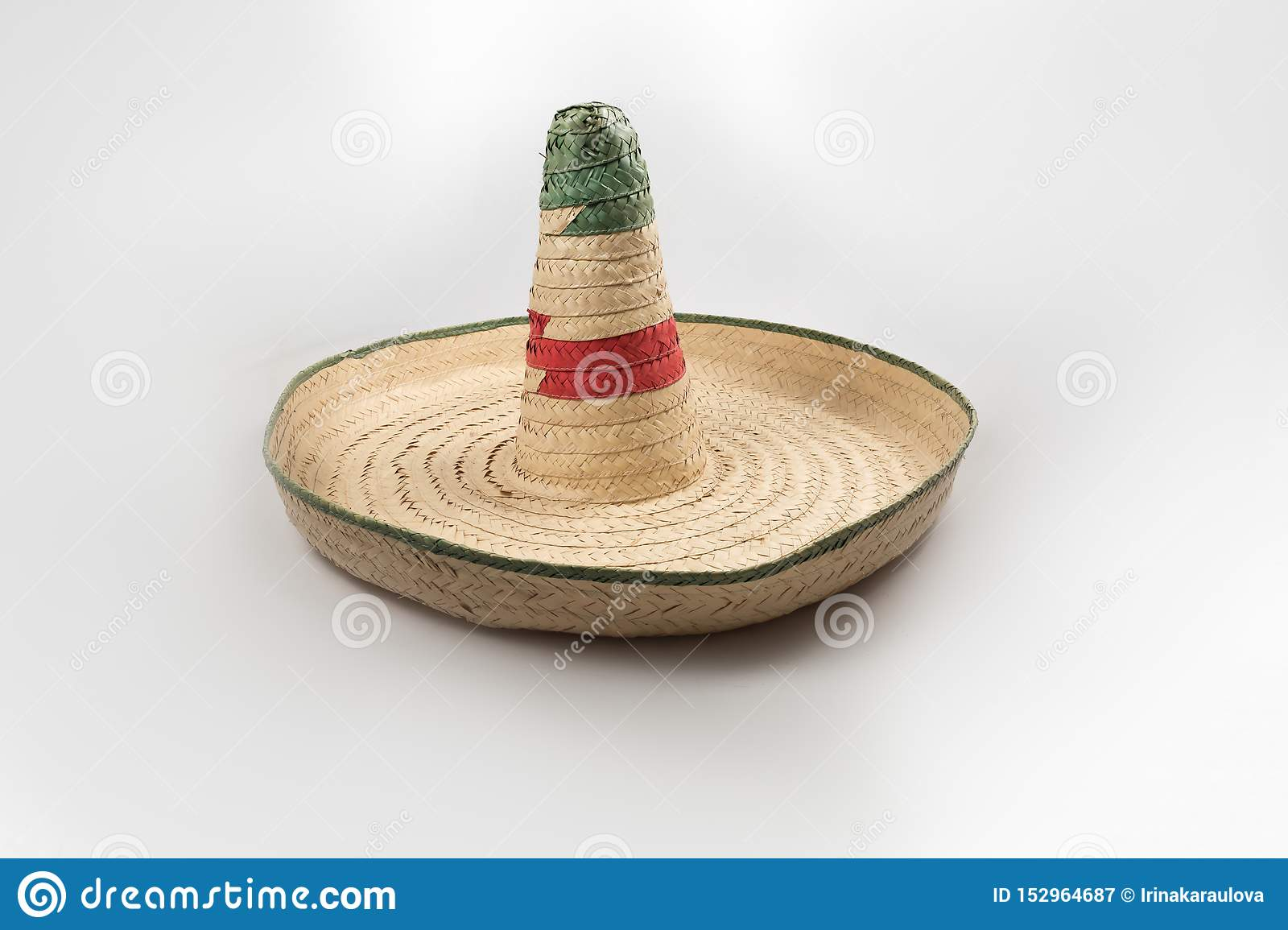 The straw Mexican sombrero hat on white background isolated