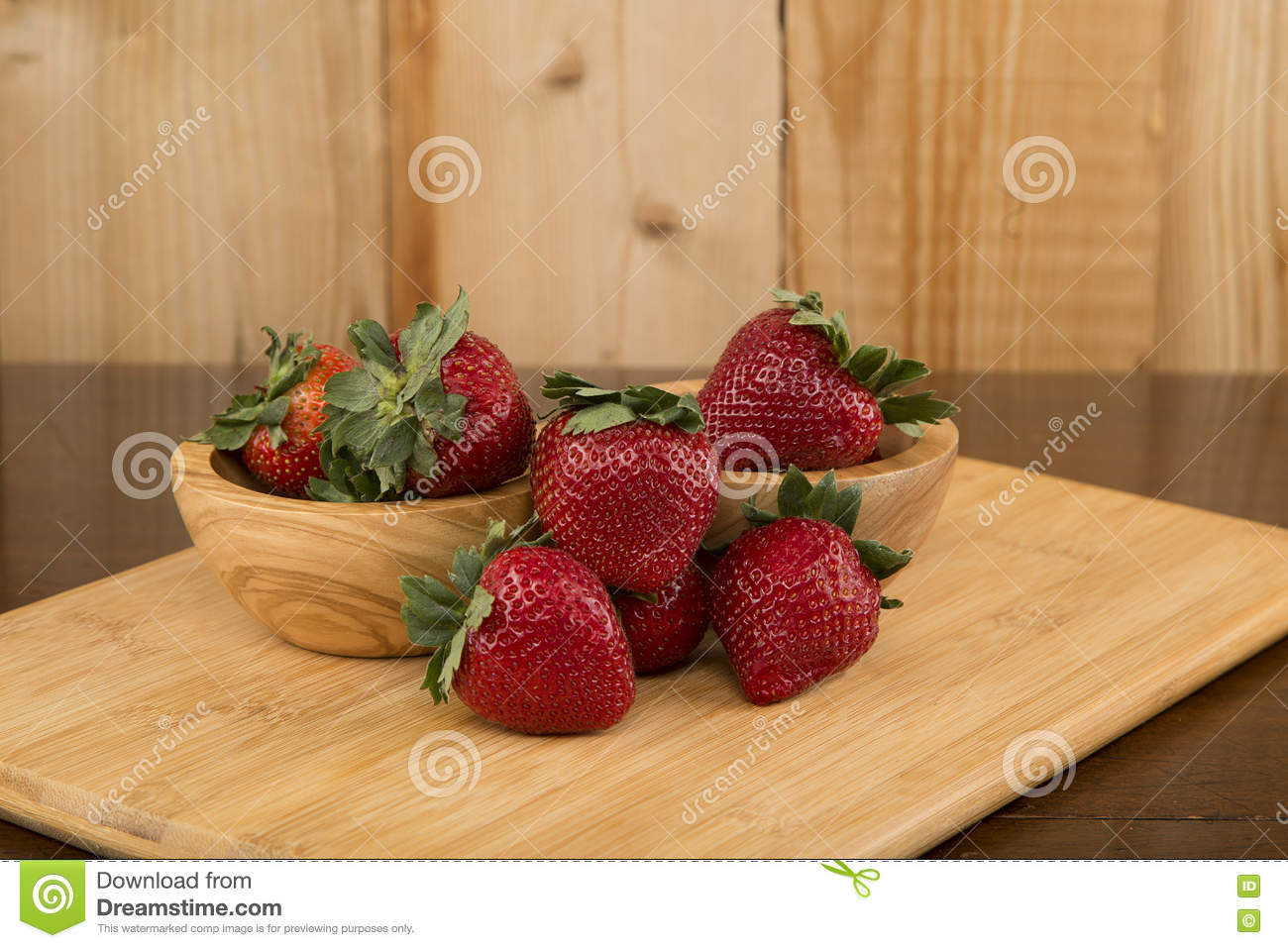 Strawberries Arranged On A Cutting Board And An Antique Table Stock