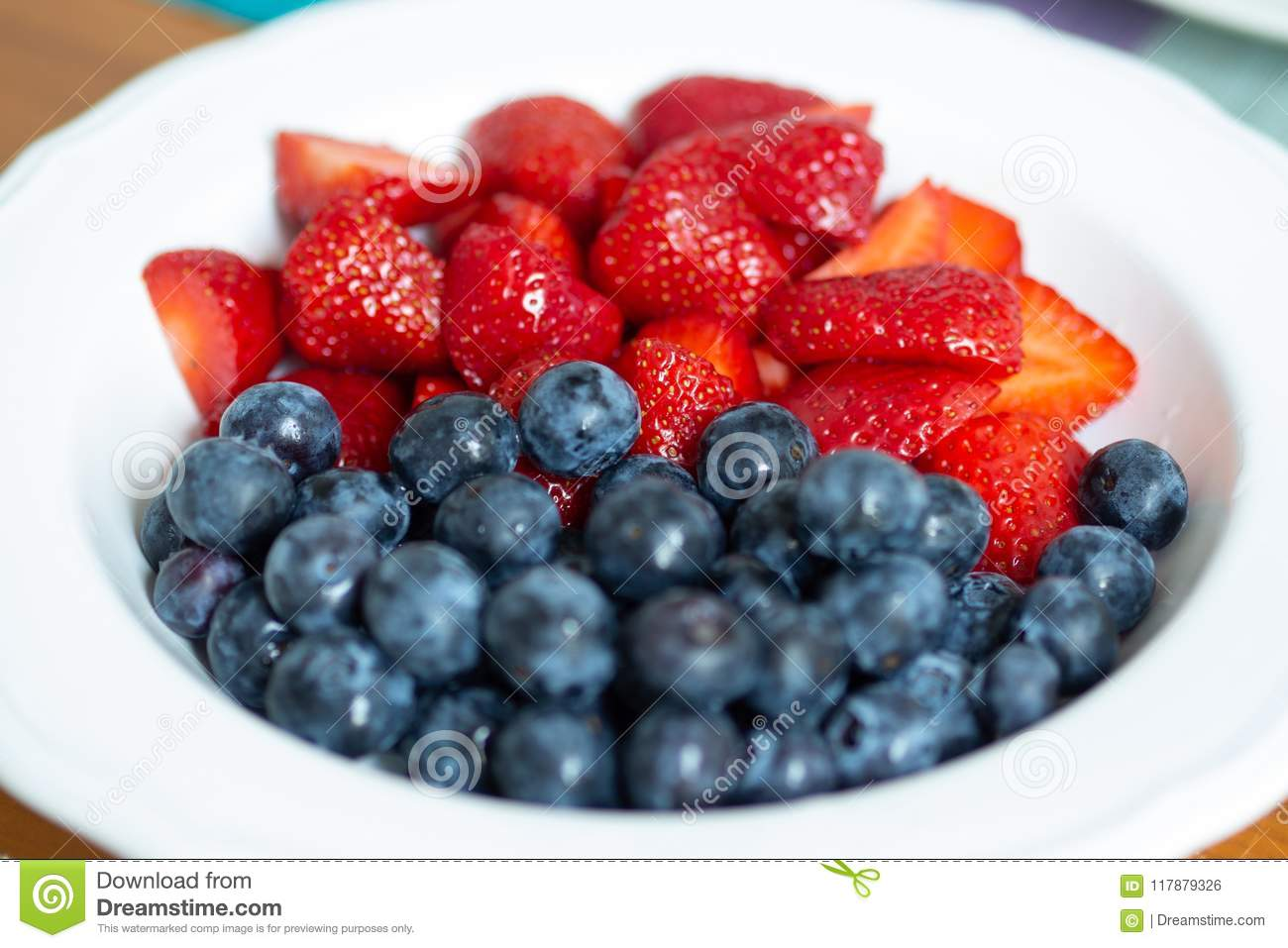 Strawberries And Blueberries In A White Bowl Stock Photo ...