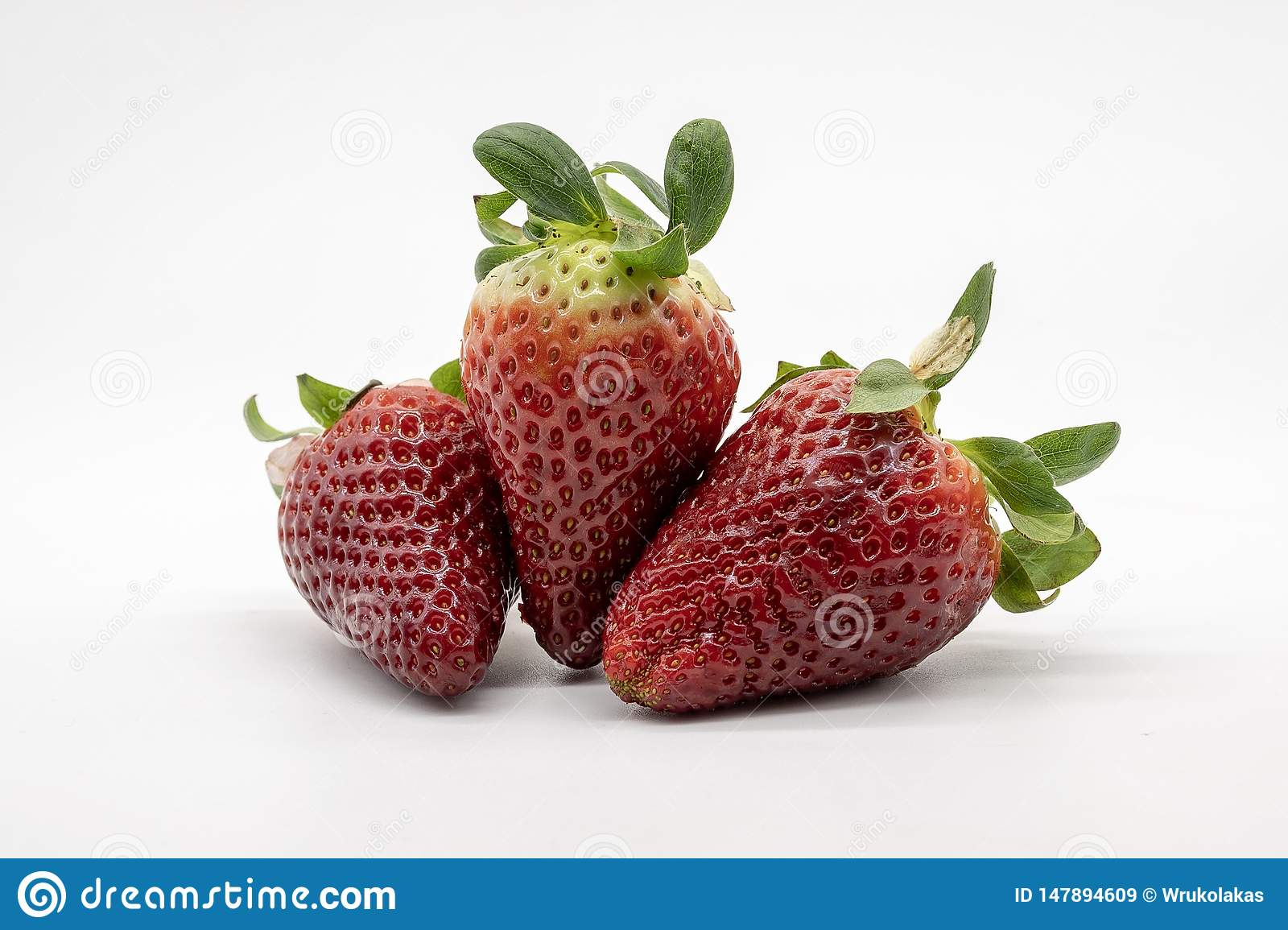 A hand full of strawberries