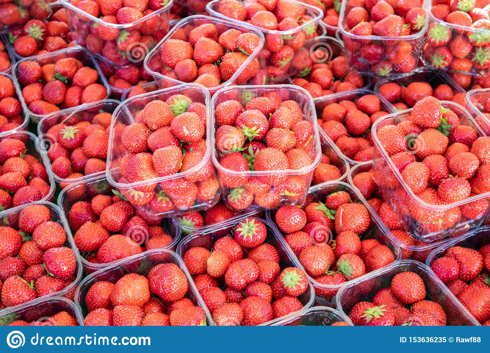 Strawberries In Plastic Containers At Farmers Market