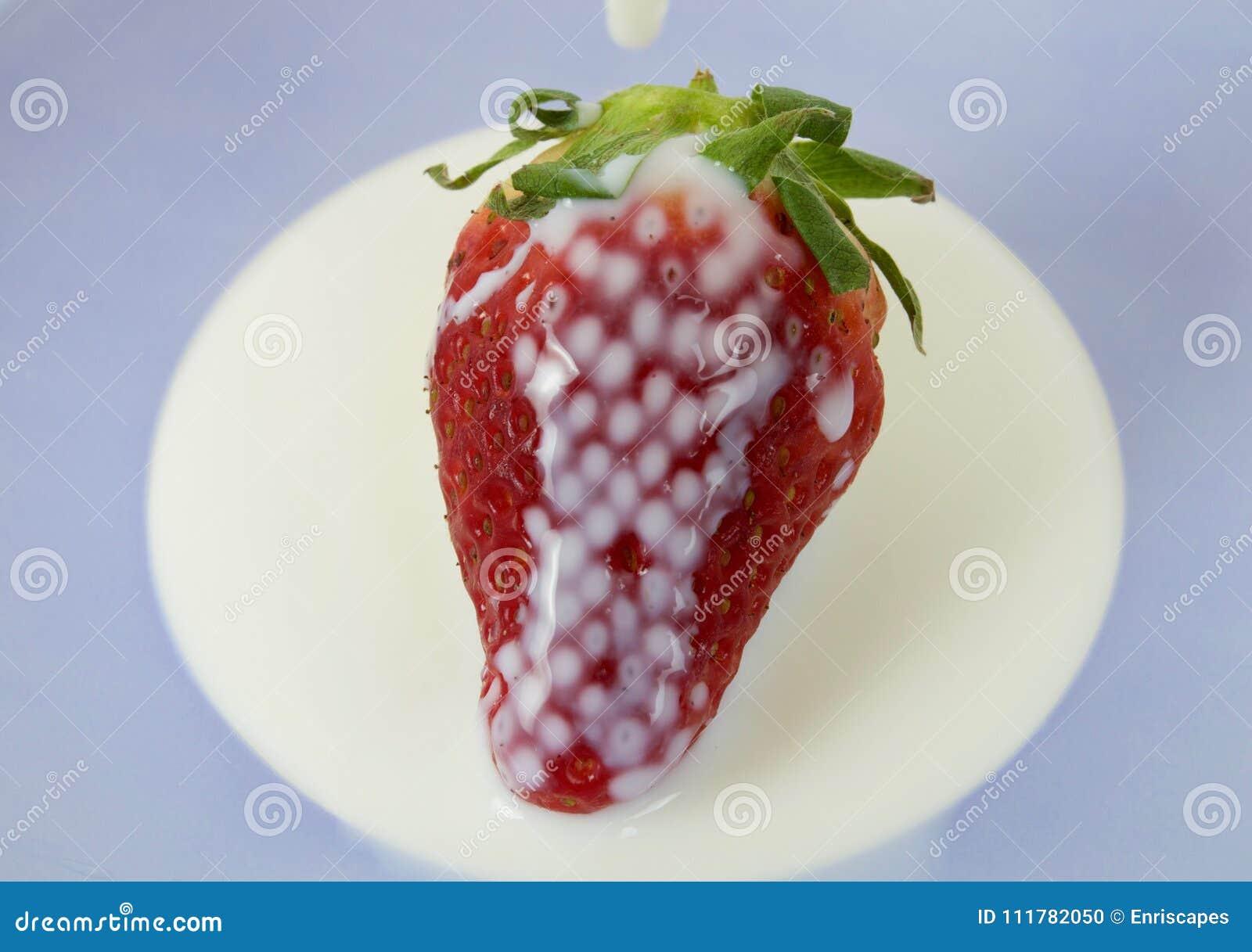 Strawberry bathed in milk