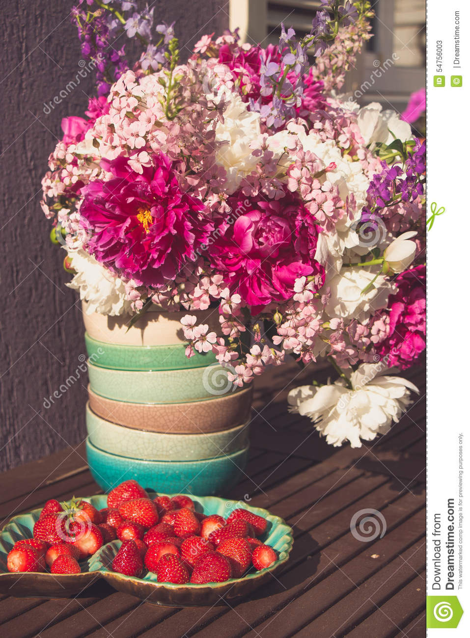 Strawberry And Bouquet Of Pink White And Violet Flowers Stock Image