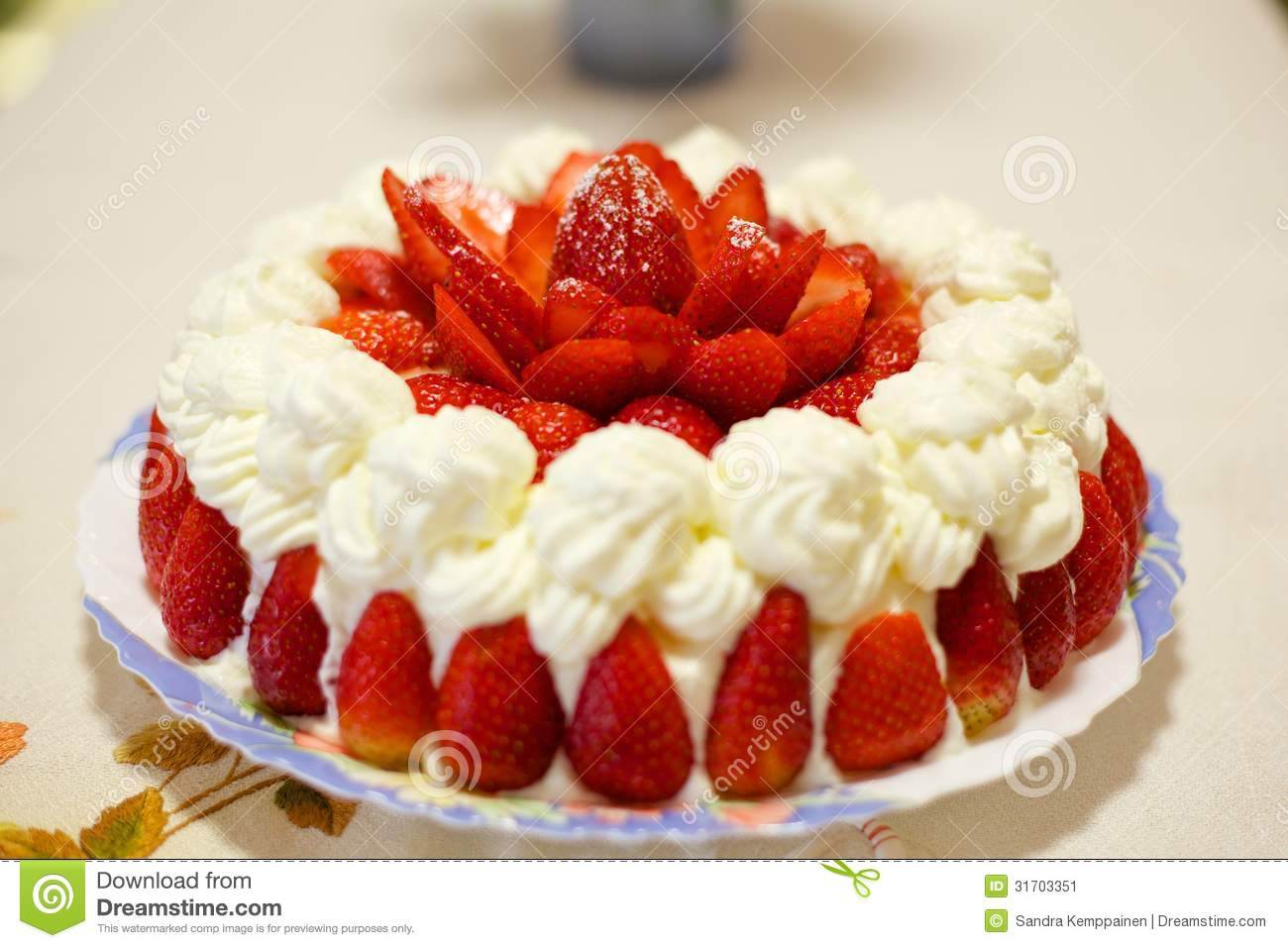 Strawberry cake with whipped cream with slices of strawberries.